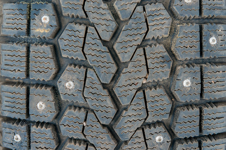 winter tires: Protector of winter tires with spikes close-up Stock Photo