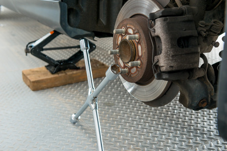 tire fitting: rear wheels and tools for tire fitting Stock Photo