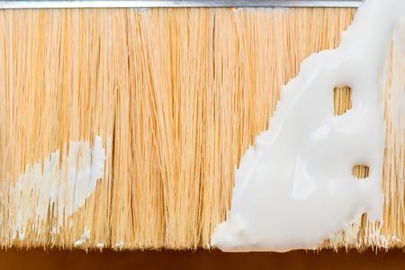 bristle: bristle paint brush close-up of white paint smeared