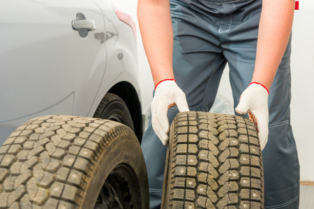 tire fitting: mechanic is preparing a Tire fitting service wheels