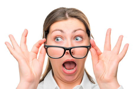 greatly: greatly shocked woman with glasses face close-up