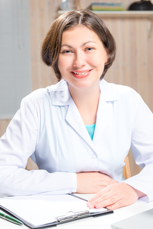 medical dressing: smiling woman doctor in a white medical dressing gown Stock Photo