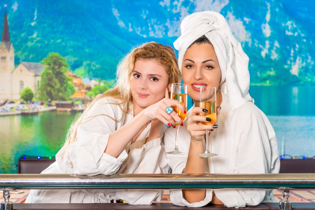 white coats: Portrait of girls in white coats after sauna Stock Photo