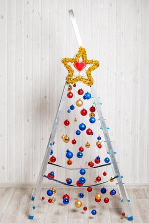beautiful and creative Christmas tree made from stepladder Imagens