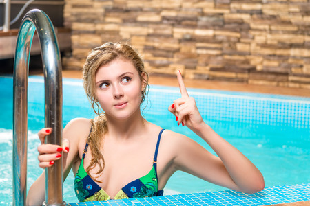 great suit: the girl in a bathing suit is a great idea - hand gesture Stock Photo