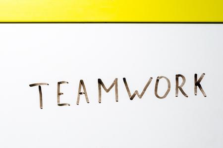 board marker: the word teamwork written on a white board marker