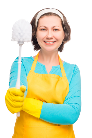 portrait of a beautiful housewife with a with the brush for cleaning toilet isolated
