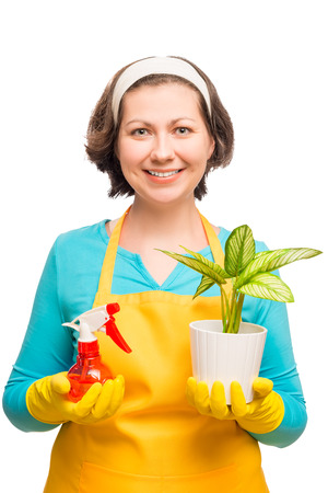 housewife holding a flower in a pot on white background shot in studio
