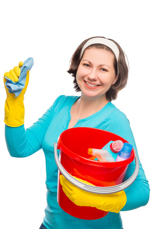 portrait of happy housewife with a bucket and cleaning materials