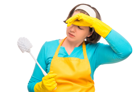 tired woman housewife with toilet cleaning brush on a white background