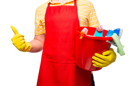 householder: male householder holding a bucket of cleaning products on a white background