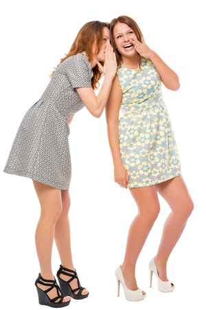 secretive: young girls quietly secretive on a white background