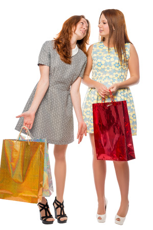 Two girls with gifts after shopping on white background