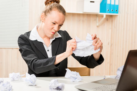 struggles: Accountant emotional struggles with stress in the office Stock Photo