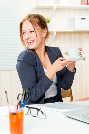 working hours: a cup of coffee to feel good during working hours at the office Stock Photo