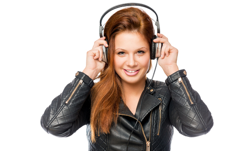 rocker girl: Rocker happy girl with headphones posing on a white background