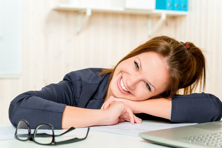 caucasian appearance: Happy business woman Caucasian appearance at the office smiling Stock Photo