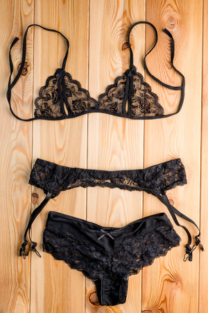 fetish wear: Womens set seductive lingerie close-up on the wooden floor