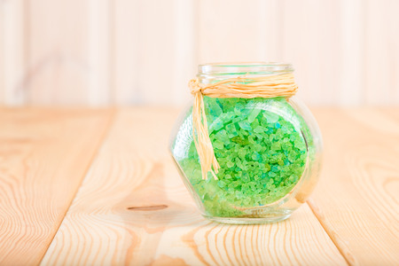 bath additive: glass jar with sea salt with natural pine extract Stock Photo