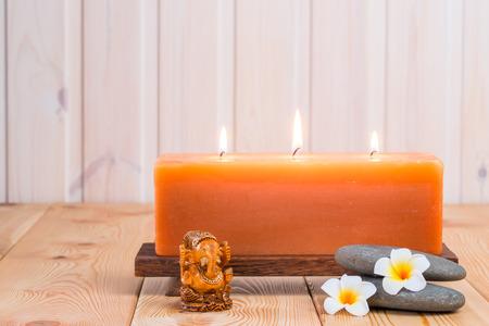 god ganesh: statue of the god Ganesh and burning candle Stock Photo