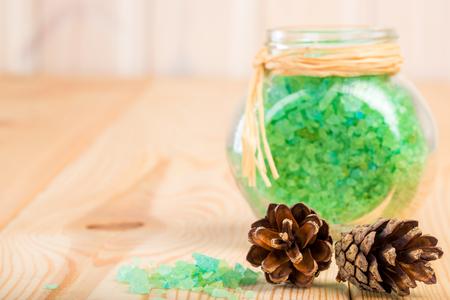 bath additive: sea salt and green natural pine cones closeup