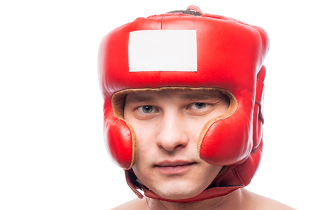 casco rojo: Portrait of a boxer in protective red helmet isolated