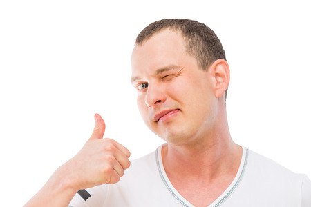satisfied man makes a gesture with thumb up isolated