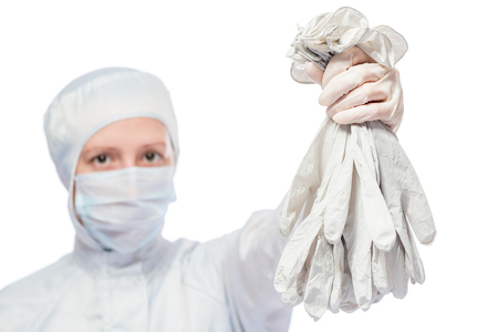 protective suit: chemist in protective suit with a bunch of rubber gloves on a white background Stock Photo