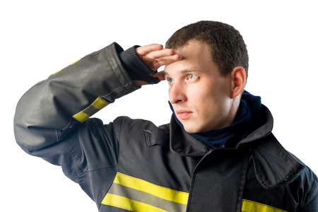 protective suit: Fireman in protective suit looks off into the distance on a white background Stock Photo