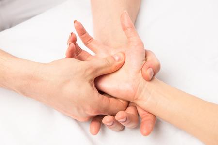 massage hands at certain points, hands close-up
