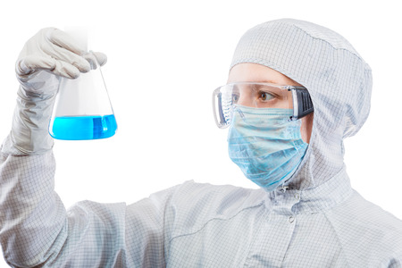 chemist biologist examines toxic liquid in flask isolated