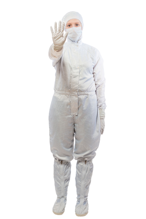 radiation protection suit: Chemist woman in a suit showing gesture STOP