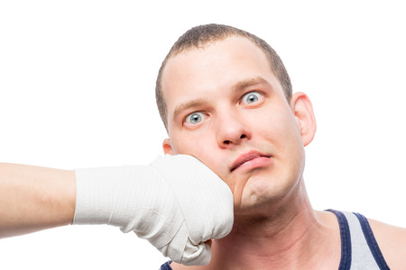 Boxer fist and opponents face on a white background isolated