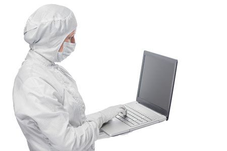 protective suit: in a protective suit Scientist working with laptop isolated Stock Photo