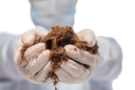 specimen testing: the soil in biology researcher hands closeup