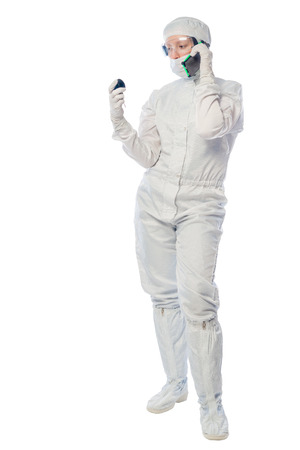 chemist researcher with a telephone and an instrument to measure radiation on a white background Stock Photo