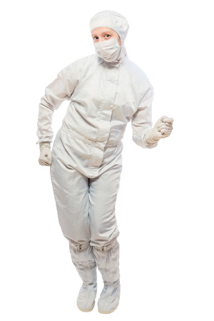 radiation protection suit: cheerful chemist dancing on a white background isolated in a protective suit Stock Photo