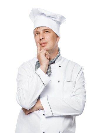 portrait of a pensive handsome chef in the working suit on a white background
