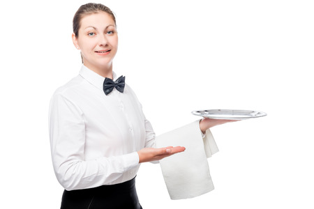 Happy waitress with an empty silver tray, portrait isolated on white background Stock Photo