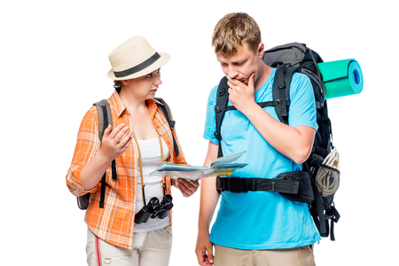 Bustling tourists think and discuss the route with a map in hand Stock Photo
