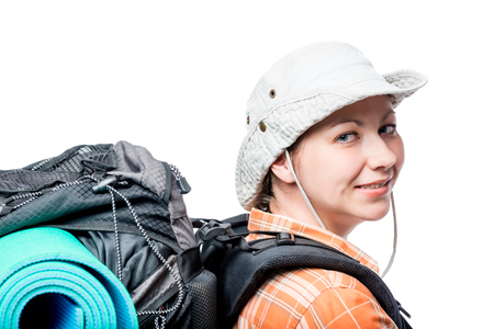 woman with a backpack looked back, portrait on a white background Stock Photo