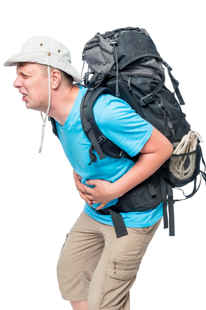 Young tourist with a backpack holding a sick stomach with hands on a white background