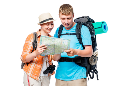 Travelers on a hike with a map and backpacks isolated Stock Photo