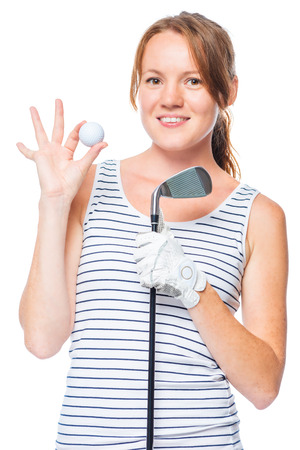 mujer deportista: Golfer holding a golf club and showing a white ball in the studio Foto de archivo