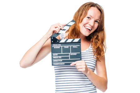 beautiful girl posing with a movie clapper on a white background