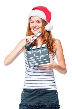Verticaal portret van een vrouwelijke cinematograaf met een filmklep bij Kerstmis
