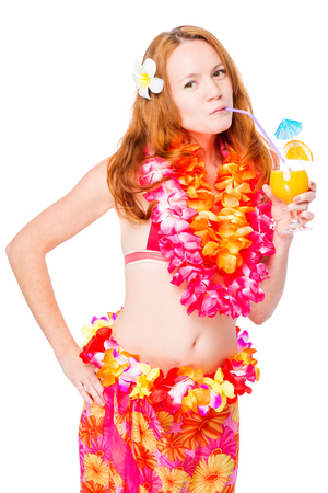 Slender girl in bikini in Hawaii lei on white background with cocktail Stock Photo