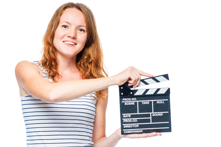 red-haired actress and movie clapper in hand on white background Stock Photo