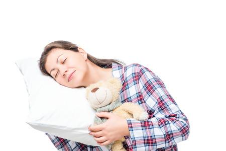 wellness sleepy: Female portrait on a soft pillow on a white background