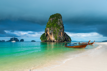 phra nang: Wooden boats and a high cliff in the sea, Thailand, Phra Nang beach